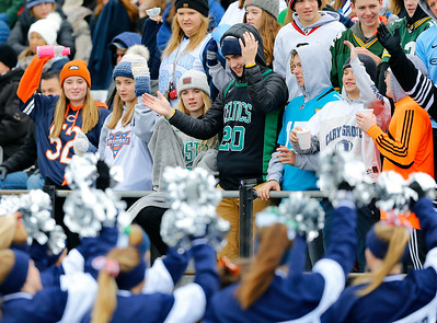 Cary-Grove fans are led by the cheerleaders as the Cary-Grove Trojans defeat the St. Ignatius (Chicago) Wolfpack 41013 in a Class 6A IHSA football playoff game on Saturday, November 2, 2019, in Cary, Ill.