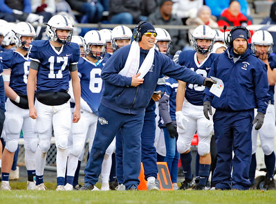 Cary-Grove coach Brad Seaburg calls a play as the Cary-Grove Trojans defeat the St. Ignatius (Chicago) Wolfpack 41013 in a Class 6A IHSA football playoff game on Saturday, November 2, 2019, in Cary, Ill.