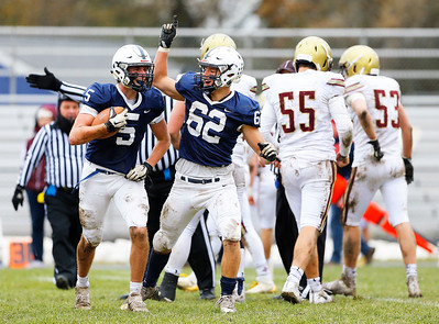 Cary-Grove's Michael Sullivan (5) celebrates his fumble recovery with Mitchel Dec (62) as the Cary-Grove Trojans defeat the St. Ignatius (Chicago) Wolfpack 41013 in a Class 6A IHSA football playoff game on Saturday, November 2, 2019, in Cary, Ill.