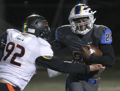 Candace H. Johnson-For Shaw Media Plainfield East's David Feltz tries to tackle Warren's Torris Childs in the fourth quarter during the Class 8A first round state playoff game at Warren Township High School in Gurnee. Warren won 49-7.  (11/2/19)