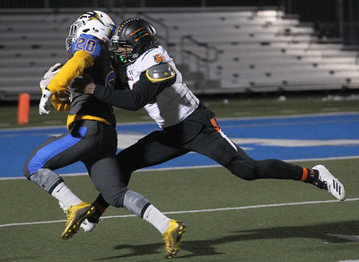 Candace H. Johnson-For Shaw Media Warren's Peara Savath tries to outrun the tackle by Plainfield East's Jabril Sims as he carries the ball in the fourth quarter during the Class 8A first round state playoff game at Warren Township High School in Gurnee. Warren won 49-7.  (11/2/19)
