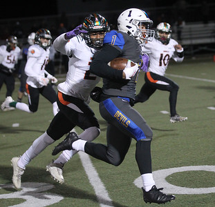 Candace H. Johnson-For Shaw Media Plainfield East's Brian Tape tries to tackle Warren's Christian Phillips as he carries the ball in the first quarter during the Class 8A first round state playoff game at Warren Township High School in Gurnee. Warren won 49-7.  (11/2/19)