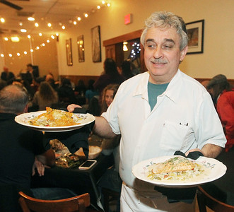 Candace H. Johnson-For Shaw Media Chef Claude Bouteille serves French cuisine to customers during Open Mic Nights at Taste of Paris in Mundelein. The event was presented by the Mundelein Arts Commission. The next Open Mic Night at Taste of Paris will be on November 15th from 6-8:30 pm.  (11/2/19)