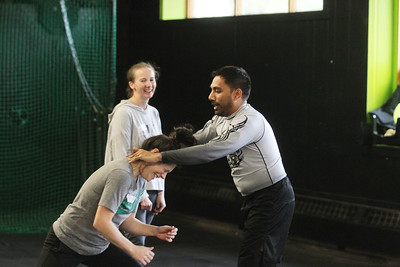 Candace H. Johnson-For Shaw Media Kim Petrie, of Grayslake watches Denise Niehus, of Antioch practice self-defense techniques with Imran Faizi, of Lake Villa, assistant coach, during the Women's Self-Defense Seminar presented by Black Tiger Martial Arts at Prime Athletics in Grayslake.  (11/2/19)