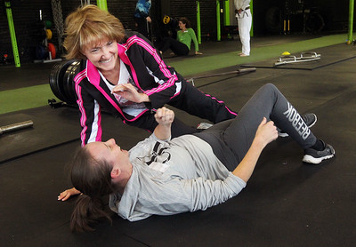 Candace H. Johnson-For Shaw Media Brenda Wade, of Vernon Hills and Kim Petrie, of Grayslake share a laugh as they practice self-defense techniques during the Women's Self-Defense Seminar presented by Black Tiger Martial Arts at Prime Athletics in Grayslake.  (11/2/19)