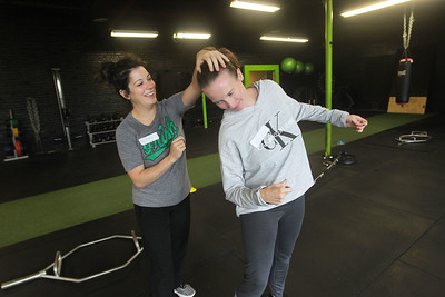 Candace H. Johnson-For Shaw Media Denise Niehus, of Antioch and Kim Petrie, of Grayslake practice self-defense techniques together during the Women's Self-Defense Seminar presented by Black Tiger Martial Arts at Prime Athletics in Grayslake.  (11/2/19)