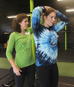 Candace H. Johnson-For Shaw Media Anna Bullman, of Grayslake and her daughter, Kate, 17, practice self-defense techniques during the Women's Self-Defense Seminar presented by Black Tiger Martial Arts at Prime Athletics in Grayslake.  (11/2/19)