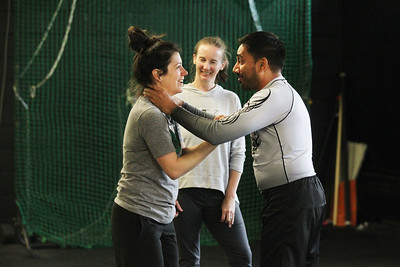 Candace H. Johnson-For Shaw Media Denise Niehus, of Antioch works with Imran Faizi, of Lake Villa, assistant instructor, on self-defense techniques as Kim Petrie, of Grayslake (in middle)  watches them during the Women's Self-Defense Seminar presented by Black Tiger Martial Arts at Prime Athletics in Grayslake.  (11/2/19)