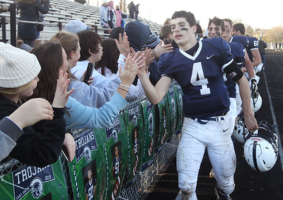Candace H. Johnson-For Shaw Media Cary-Grove's quarterback, Lukas Eleftheriou, greets the crowd after his varsity football team beat Antioch 14-7 during the Class 6A second-round playoff game at Cary-Grove High School.