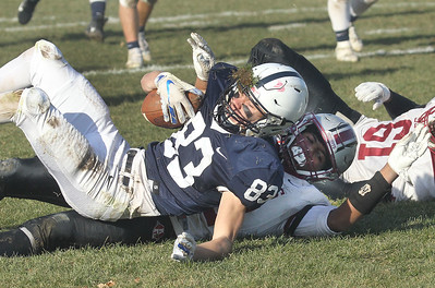 Candace H. Johnson-For Shaw Media Cary-Grove's Ethan Carlson gets tackled by Antioch's Jackson DeVaughn and Elkanah Gahima in the third quarter during the Class 6A second-round playoff game at Cary-Grove High School.  Cary-Grove won 14-7.