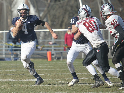 Candace H. Johnson-For Shaw Media Cary-Grove's Lukas Eleftheriou runs the ball as Ethan Carlson blocks Antioch's Dino Kaliakmanis in the second quarter during the Class 6A second-round playoff game at Cary-Grove High School.  Cary-Grove won 14-7.