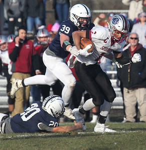 Candace H. Johnson-For Shaw Media Antioch's TreShawn Watson tries to break the tackle attempt by Cary-Grove's Blake Skol and John Gagliano, Jr. during the Class 6A second-round playoff game at Cary-Grove High School. Cary-Grove won 14-7. (11/9/19)