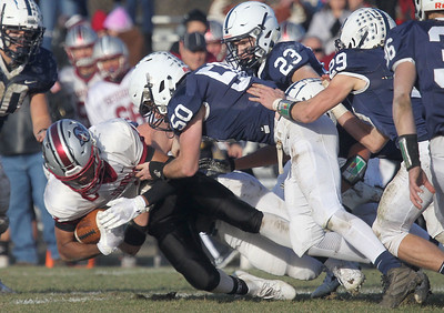 Candace H. Johnson-For Shaw Media Antioch's TreShawn Watson gets tackled by several Cary-Grove defenders in the fourth quarter during the Class 6A second-round playoff game at Cary-Grove High School.  Cary-Grove won 14-7.