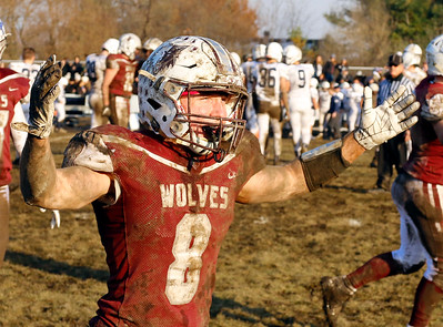 Prairie Ridge Wolves' Kyle Koelblinger (8) celebrates as the Wolves defeated the Cary-Grove Trojans 14-13 in a Class 6A IHSA football quaterfinal playoff game on Saturday, November 16, 2019, in Crystal Lake, Ill.