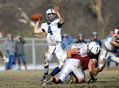 Cary-Grove Trojans' Lukas Eleftheriou (4) fades back to pass as the Prairie Ridge Wolves defeated the Trojans 14-13 in a Class 6A IHSA football quaterfinal playoff game on Saturday, November 16, 2019, in Crystal Lake, Ill.