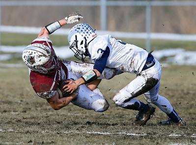 Prairie Ridge's Kyle Koelblinger (8) is tackled by Cary-Grove's Nathan Splitt (3). The Prairie Ridge Wolves defeated the Cary-Grove Trojans 14-13 in a Class 6A IHSA football quaterfinal playoff game on Saturday, November 16, 2019, in Crystal Lake, Ill.