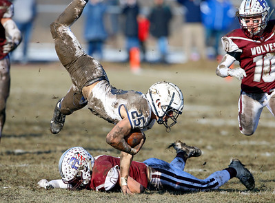 Cary-Grove Trojans' Gregory Mistak (25) is upended as the Prairie Ridge Wolves defeated the Trojans 14-13 in a Class 6A IHSA football quaterfinal playoff game on Saturday, November 16, 2019, in Crystal Lake, Ill.