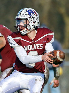 Prairie Ridge Wolves' Connor Lydon (9) hands off the ball as the Wolves defeated the Trojans 14-13 in a Class 6A IHSA football quaterfinal playoff game on Saturday, November 16, 2019, in Crystal Lake, Ill.