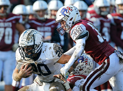 Cary-Grove Trojans' Blake Skol (20) is tackled by Prairie Ridge Wolves' Matt Fryer (38) as the Wolves defeated the Trojans 14-13 in a Class 6A IHSA football quaterfinal playoff game on Saturday, November 16, 2019, in Crystal Lake, Ill.