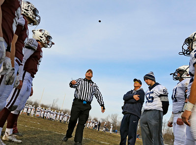 Referee Bob Ciulla does the coin toss before the Prairie Ridge Wolves defeated the Cary-Grove Trojans 14-13 in a Class 6A IHSA football quaterfinal playoff game on Saturday, November 16, 2019, in Crystal Lake, Ill.