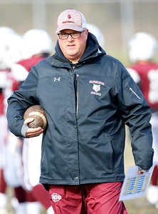 Prairie Ridge Trojans coach Chris Schremp watches pre-game warmups before the Wolves defeated the Trojans 14-13 in a Class 6A IHSA football quaterfinal playoff game on Saturday, November 16, 2019, in Crystal Lake, Ill.
