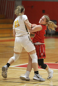 Candace H. Johnson-For Shaw Media Carmel's Emma Berg fights for control with Grant's Kaitlyn Flader in the second quarter during the Girls Thanksgiving Basketball Tournament at Mundelein High School. Carmel won 40-29. (11/18/19)