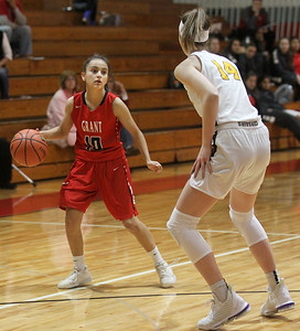 Candace H. Johnson-For Shaw Media Grant's MaCalyn Flores drives against Carmel's Grace Sullivan in the first quarter during the Girls Thanksgiving Basketball Tournament at Mundelein High School. Carmel won 40-29. (11/18/19)