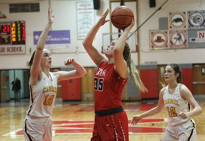 Candace H. Johnson-For Shaw Media Grant's Jazzlyn Linbo (#35) puts up a shot over Carmel's Grace Sullivan as Kaytlyn Matz defends in the fourth quarter during the Girls Thanksgiving Basketball Tournament at Mundelein High School. Carmel won 40-29. (11/18/19)