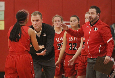 Candace H. Johnson-For Shaw Media Grant's Ashlyn Santos comes off the court and is greeted by Kevin Geist, head coach, and Matt Lukemeyer, assistant coach, in the second quarter against Carmel during the Girls Thanksgiving Basketball Tournament at Mundelein High School. Carmel won 40-29. (11/18/19)