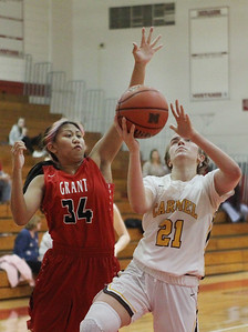 Candace H. Johnson-For Shaw Media Grant's Ashlyn Santos tries to block a shot by Carmel's Emma Berg in the third quarter during the Girls Thanksgiving Basketball Tournament at Mundelein High School. Carmel won 40-29. (11/18/19)