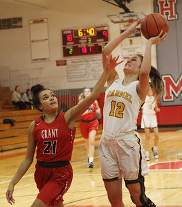 Candace H. Johnson-For Shaw Media Grant's Katelyn Dupree tries to block a shot by Carmel's Kaytlyn Matz in the third quarter during the Girls Thanksgiving Basketball Tournament at Mundelein High School. Carmel won 40-29. (11/18/19)