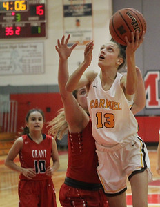 Candace H. Johnson-For Shaw Media Grant's Jazzlyn Linbo tries to block a shot by Carmel's Jordan Wood in the third quarter during the Girls Thanksgiving Basketball Tournament at Mundelein High School. Carmel won 40-29. (11/18/19)