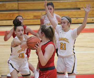 Candace H. Johnson-For Shaw Media Grant's Jazzlyn Linbo (center) gets her shot blocked by Carmel's Jordan Wood as Emma Berg defends in the second quarter during the Girls Thanksgiving Basketball Tournament at Mundelein High School. Carmel won 40-29. (11/18/19)