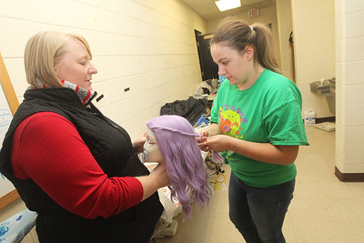 Candace H. Johnson-For Shaw Media Marissa Myers, of Fox Lake, costume director, helps her daughter, Caitrin, 14, as she works on styling a wig for a purple fairy during technical preparation for Midsummer Night's Dream by William Shakespeare at Grant Community High School in Fox Lake. The play runs on Friday, November 22nd at 7:00 pm, Saturday, November 23rd at 7:00 pm and Sunday, November 24th at 2:00 pm. (11/19/19)
