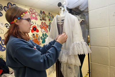 Candace H. Johnson-For Shaw Media Costumer Elena Hevrdejs, 15, of Lake Villa decides on whether a decorative pin should be used to attach a jacket and dress together will work which will be worn by one of the main characters during technical preparation for Midsummer Night's Dream by William Shakespeare at Grant Community High School in Fox Lake. The play runs on Friday, November 22nd at 7:00 pm, Saturday, November 23rd at 7:00 pm and Sunday, November 24th at 2:00 pm. (11/19/19)