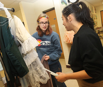 Candace H. Johnson-For Shaw Media Costumers Elena Hevrdejs, 15, of Lake Villa talks with Rachel Manlubatan, 16, of Round Lake about the costume for one of the main characters in the play during technical preparation for Midsummer Night's Dream by William Shakespeare at Grant Community High School in Fox Lake. The play runs on Friday, November 22nd at 7:00 pm, Saturday, November 23rd at 7:00 pm and Sunday, November 24th at 2:00 pm. (11/19/19)