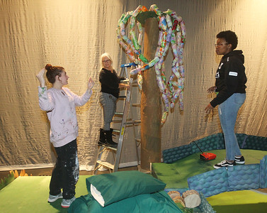 Candace H. Johnson-For Shaw Media Penny Zegler, (center) art teacher and set designer, talks with Lizandra Barajas, 17, of Fox Lake and Nia Nelson, 14, of Round Lake about the willow trees in the forest made of recycled materials during technical preparation for Midsummer Night's Dream by William Shakespeare at Grant Community High School in Fox Lake. The play runs on Friday, November 22nd at 7:00 pm, Saturday, November 23rd at 7:00 pm and Sunday, November 24th at 2:00 pm. (11/19/19)