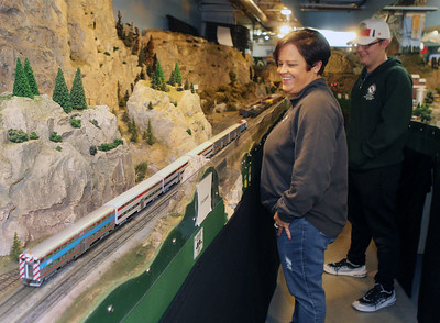 Candace H. Johnson-For Shaw Media Jennifer Speer, of Lake in the Hills stands next to her son, J.J., 16, as he controls his Metra model train as it goes by during the Lake County Model Railroad Club's Fall Open House in Wauconda. (11/16/19)