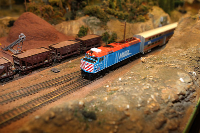 Candace H. Johnson-For Shaw Media The Metra model train, owned by J.J. Speer, 16, of Lake in the Hills runs through the HO scale permanent operating layout during the Lake County Model Railroad Club's Fall Open House in Wauconda. (11/16/19)