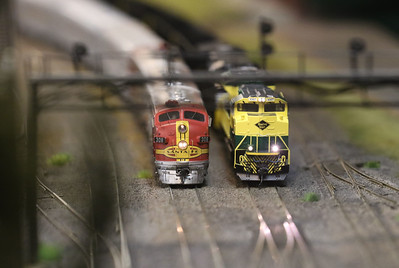 Candace H. Johnson-For Shaw Media The Santa Fe El Capitan and the Norfolk Southern model trains sit side-by-side on the HO scale permanent operating layout during the Lake County Model Railroad Club's Fall Open House in Wauconda. (11/16/19)