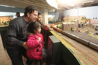 Candace H. Johnson-For Shaw Media Terry Hodera, of Wauconda and his grandchildren, Mya Dababneh, 8, of Fox Lake and her brother, Jordan, 8, watch a model train go by on the HO scale permanent operating layout during the Lake County Model Railroad Club's Fall Open House in Wauconda. (11/16/19)
