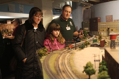 Candace H. Johnson-For Shaw Media Elizabeth and Steve Greenup, of Volo and their daughter, Natalie, 9, watch Steve's model train go by during the Lake County Model Railroad Club's Fall Open House in Wauconda. (11/16/19)
