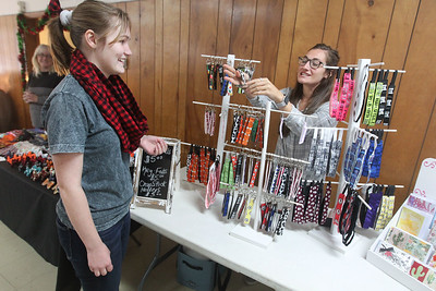 Candace H. Johnson-For Shaw Media Marian Cheatham, 16, talks with Alicia Hook, 22, both of Lake Villa about the key fobs she was selling during the Venetian Village Craft Show in Lake Villa. (11/16/19)