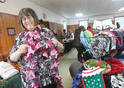 Candace H. Johnson-For Shaw Media Sharon Rowe, of Lake Villa demonstrates how to wear one of her handmade crocheted scarves during the Venetian Village Craft Show in Lake Villa. (11/16/19)