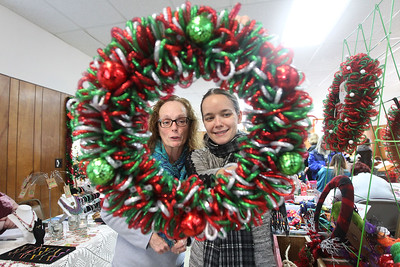 Candace H. Johnson-For Shaw Media Rhonda Stoner, of Third Lake checks out the Christmas wreath her daughter-in-law, Sarah Ludford, of Lake Villa was selling during the Venetian Village Craft Show in Lake Villa. (11/16/19)