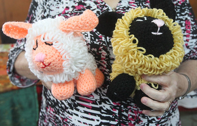 Candace H. Johnson-For Shaw Media Sharon Rowe, of Lake Villa shows the handmade crocheted animals she was selling during the Venetian Village Craft Show in Lake Villa. (11/16/19)