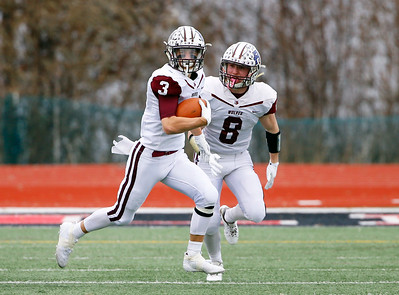 Prairie Ridge's Blake Brown (3) runs the ball with encouragement from Kyle Koelblinger (8) as the Prairie Ridge Wolves defeat the Deerfield Warriors 49-16 in a Class 6A IHSA football semi-final playoff game on Saturday, November 23, 2019, in Deerfield, Ill.