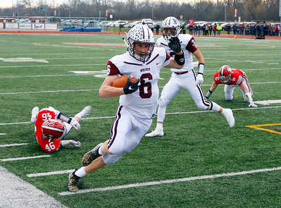 The XXX defeated the XXX XX-XX in a Class 6A IHSA football semi-final playoff game on Saturday, November 23, 2019, in Deerfield, Ill.