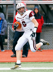 Prairie Ridge's Taidhgin Trost (6) runs the ball as the Prairie Ridge Wolves defeat the Deerfield Warriors 49-16 in a Class 6A IHSA football semi-final playoff game on Saturday, November 23, 2019, in Deerfield, Ill.