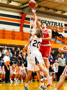 Aaron Sarkar (10) goes over Lucas Wagner (20) for a shot as the Barrington Broncos defeated the Crystal Lake Central Tigers 75-45 in a boys varsity basketball game on Monday, November 25, 2019, in Crystal Lake, Ill.
